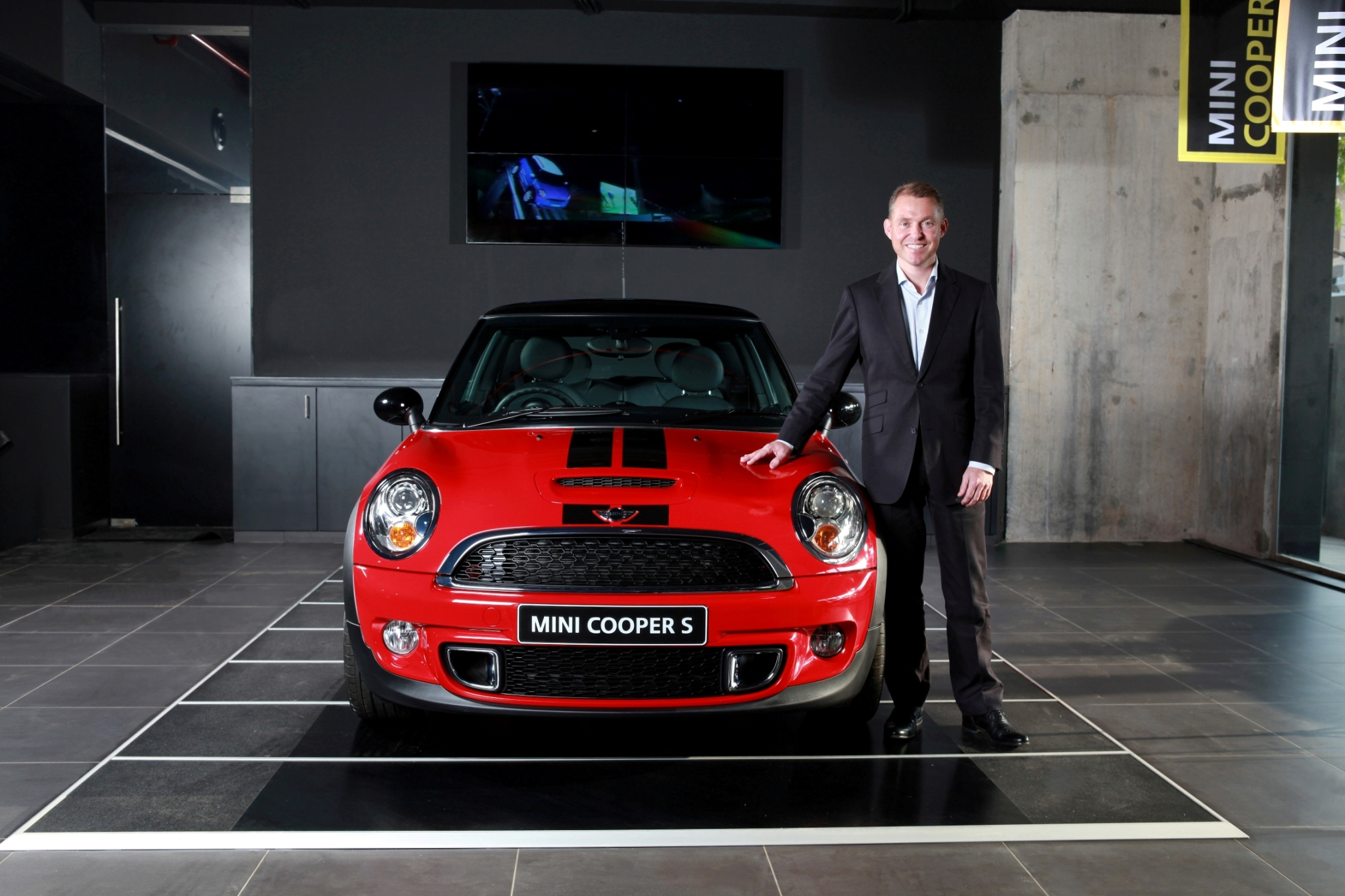 April 5, 2012-Dr.-Andreas-Schaaf-President-BMW-Group-India-with-the-MINI.jpg