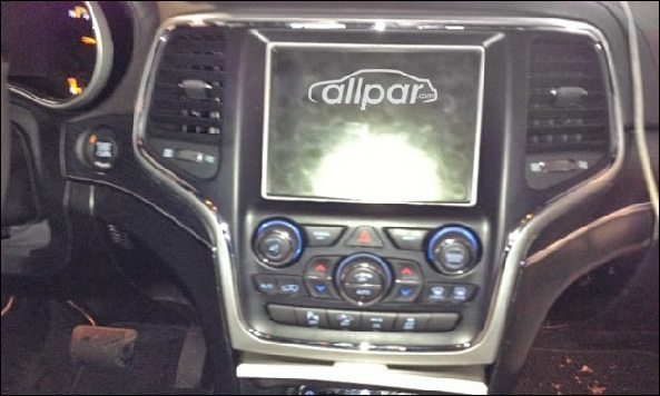 On the inside, the 2014 Jeep Grand Cherokee gets the UConnect
