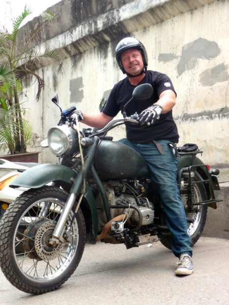 Charley-Boorman-on-the-650cc-Ural-on-set-filming-Freedom-Riders-Asia-in-Vietnam-450x600