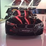 A Black Sapphire BMW M4 coupe showcased at North America International Auto Show